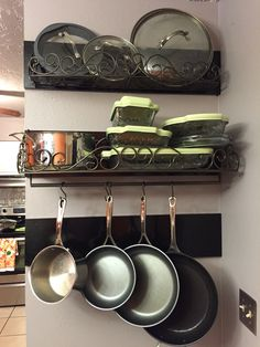 Princess House cookware organizer shelves hung on a DIY 1x8 pine and stained with a classic black satin.