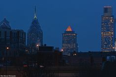 The Mellon Bldg. with the pyramidal peak changes colors at night. I posted three photos of the skyscraper to show the different colors.