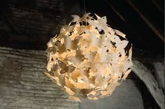 Designed by Diffuse Studio, Butterfly Ball is a dramatic spherical chandelier composed of numerous translucent porcelain butterflies each embossed with a delicate damask texture. The butterflies appear to be gathering around a central point as though drawn to the light.