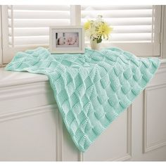 My favorite source for arts and crafts:  Cushy Crocheted Blanket