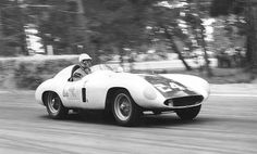 Carroll Shelby -- Ferrari 750 Monza Carroll Shelby on his way to victory in the Del Monte Trophy event at Pebble Beach, 1956.  The car is Dick Hall's Ferrari 750 Monza.  Phil Hill won this event in the same car the year before.