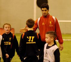 Liverpool's first-team players pay a special Academy visit