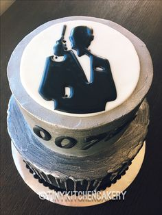 007 - James Bond cake - black and silver cake - ganache drip     Www.facebook.com/tinykitchencakery