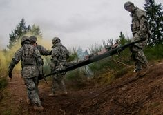 https://flic.kr/p/eaKeqy | Litter squad | Pfc. Steven Williams, 520th Area Support Medical Company, 56th Multifunctional Medical Battalion, 62nd Medical Brigade, Joint Base Lewis-McChord, Wash., leads a four-person litter squad down terrain while testing to earn the Expert Field Medical Badge on JBLM-North April 10. The EFMB is a prestigious Department of the Army-level badge for the recognition of exceptional competence and outstanding performance by field medical personnel. It is a test of…
