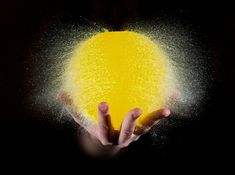 High-Speed Photographs of Water Balloons as They Burst