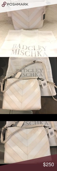 "NWT Badgley Mischka Remy Snake-Embossed Crossbody NWT never been worn Badgley Mischka smooth and snake-embossed leather bag in chevron pattern - white Gunmetal hardware. Flat top handle with hanging logo tag, 8.5"" drop. Removable, adjustable shoulder strap, 20.5"" drop. Zip top closure. Interior, center zip compartment; one zip and two slip pockets. Logo jacquard lining. 10.5""H x 11""W x 2""D. Badgley Mischka Bags Crossbody Bags"