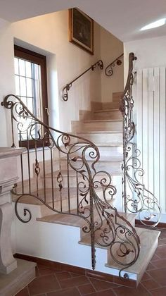 Corner wrought iron balustrade with floral decorationsYou can find Wrought iron decor and more on our website.Corner wrought iron balustrade with floral decorations Wrought Iron Stair Railing, Stair Railing Design, Wrought Iron Decor, Stair Decor, Railings, Interior Stairs, Interior Architecture, Beautiful Stairs, House Stairs