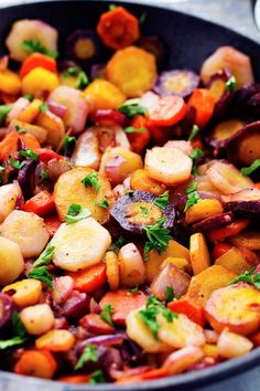 Vibrant colored rainbow carrots get sautéed in brown butter and garlic creating a delicious side dish. They are so tender and flavorful and will become a favorite new side! I love finding delicio…