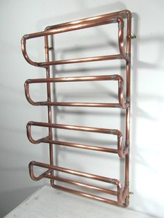 Bent Copperz - put a bit of industrial French justice into your home with this hand crafted copper pipe towel rack. Reclaimed copper piping in 0.7 or 16 mm copper pipe, soldered together for maximum strength. This towel rack accepts 4 rolled up towels be hung on the wall. 4 brass coloured wall fittings are provided with your order. The unit is made from reclaimed French copper, cleaned up and soldered with silver coloured solder. The product has been varnished using a high quality, light…
