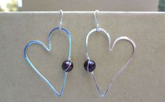 Hammered sterling silver heart shaped earrings with garnet beads by ARTdesignsbyannart, $37.00