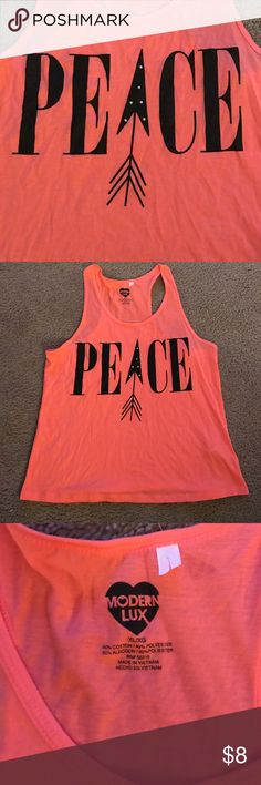Peace Tank Top Soft and comfy tank, new without tags. Only worn once! No holes, stains or tears. Super cute with a pair of cutoff shorts, leggings or jeans! (Smoke Free Home) Modern Lux Tops Tank Tops
