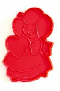 """Hallmark Girl with a Heart Cookie Cutter Price: $12.00 Material - Soft Plastic   Color - Red   Size - 3 3/4"""" x 2 1/2""""   Year Made - 1984   Please note cutters are vintage and may show wear. Place order at http://www.cookiecuttersplus.com/content-product_info/product_id-2033/hallmark_girl_with_a_heart_cookie_cutter.html"""
