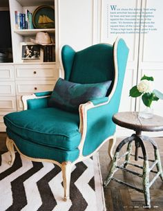 Sitting area designed with mix of modern & traditional ... turquoise chair, chevron rug & rustic table