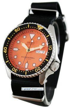 Montre Seiko Diver automatique,bracelet en nylon Nato, modèle de plongée cadran orange et lunette noire et jaune.