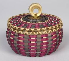 """Sarah Sockbeson, Penobscot Traditional brown ash and sweetgrass basket with deer antler handle Donated by Nicholas Halsdorff Brown ash, sweetgrass, deer antler, approximately 2"""" tall x 2.5"""" wide"""