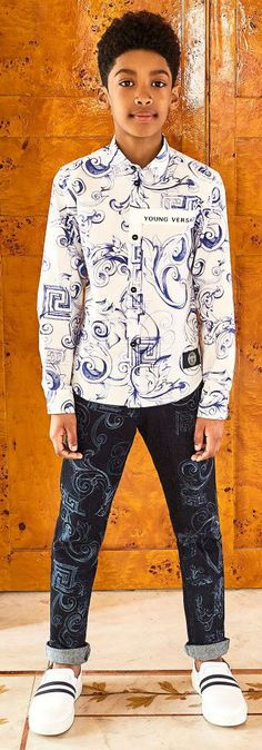 Amazing streetwear look for boys by Young Versace. Featured in the Childrensalon Eid photoshoot, this blue and white shirt with signature Baroque and Greek Fret motifs. Looks perfect with these dark blue cotton denim jeans by Young Versace that make an interesting twist to everyday jeans, with an architectural style baroque print. #EID #youngversace #versace #boysclothes#boysclothing#boysfashion#kidsfashion