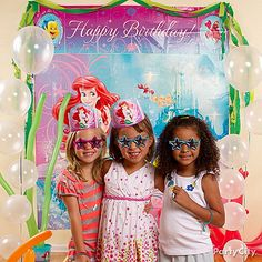 Make an under-the-sea photo booth with a scene-setter and fun photo props for your mer-guests! Say cheese!