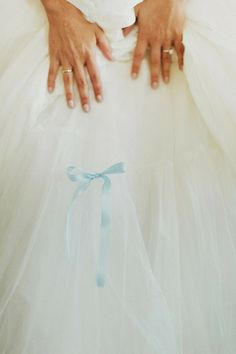If you have a fuller dress, tie a bit of blue ribbon into the under layer of tulle. It's so pretty, feminine, and easy to execute.