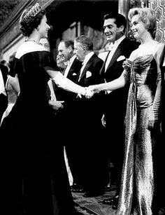 Queen Elizabeth II and Marilyn Monroe, both aged 30 -- and Victor Mature, aged 43, 1956