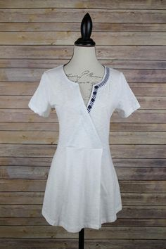 Button detail v-neck peplum white summer t-shirt.
