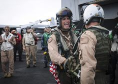 "GULF OF OMAN (Aug. 28, 2013) -- Capt. Rob Osterhoudt, deputy commander, Carrier Air Wing (CVW) 11, left, and Cmdr. Robert Loughran, commanding officer of the ""Argonauts"" of Strike Fighter Squadron (VFA) 147, congratulate each other on board the aircraft carrier USS Nimitz (CVN 68) upon completing their 1,000th carrier arrested landing, or ""trap"", Aug. 28. Nimitz Strike Group is deployed to the U.S. 5th Fleet area of responsibility conducting maritime security operations, theater security…"