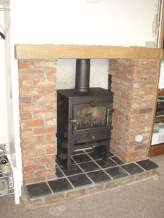 Clearview Vision multifuel stove with integral logstore, beam and slate tile hearth Stove Installation, Slate Hearth, Multi Fuel Stove, New Forest, Wood Burning, Beams, Photo Galleries, Tile, Kitchens