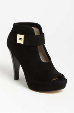 MICHAEL Michael Kors 'Devenport' Bootie available at #Nordstrom  Super comfy even with that heel!  Anniversary sale at $129.90.  Only pair left is a size 5!