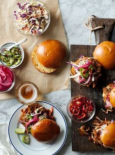 Pulled Pork Sandwiches | Using our recipe, which calls for a slow cooker and our exclusive pulled pork starter, you can savor fork-tender, flavorful pork at home without the need to stoke a barbecue.