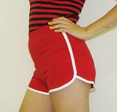 yikes! we all wore these awful running shorts from the 1970s..I had baby blue and white and red and white like these.