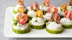 It doesn't get much easier than these. Mix together cream cheese with herbs and use it to top perfectly pretty cucumber slices. Finish it off with a cherry tomato for a burst of summer flavor!