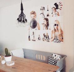 Gave fotocollage aan de muur.