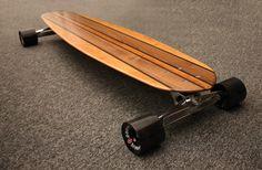 """ERIE Boards 48"""" x 9,5"""" """"CUNSTOMADE"""" numeradas realizada en cinco tipos de madera noble montada con ejes Origianl S10, rodamientos precisión SKF 608ZZ, spacers Prohibitión y ruedas Oust Mood 76mm/80A."""