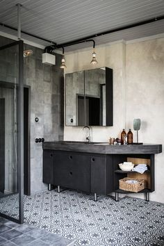 Love the morroccan tile and dark hues to this bathroom.