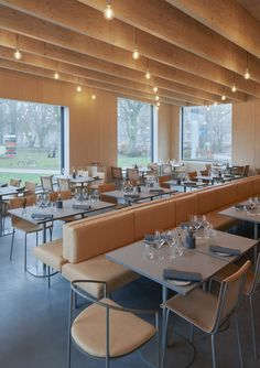 While the new extension's double-height foyer space was designed to sit comfortably next to the museum's existing large volumes and the grown trees of the park, the new restaurant is just one-storey high, so as not to block the view from a window in the museum's previous 2005 extension by architect Johan Celsing.
