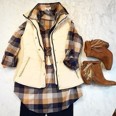 Another shipment of fabulous goodies arrived from @tylerboeclothing today!! We loved everything we unpacked including this puffy cream vest and plaid top! Paired with @lyssefashion denim leggings and @sam_edelman booties. Love!!! #tfssi #stsimons #seaisland #fall2015 #newarrivals #plaid #fringe #lovethislook
