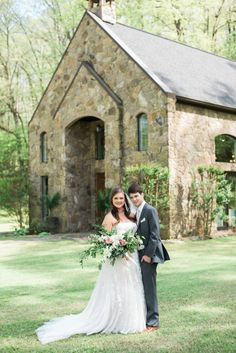 Spring wedding. April Wedding. Spring colors. Blush, ivory, sage green, magenta wedding colors. Bride and groom. Couple portraits. St. John's Chapel by the Creek in Benton, Arkansas. Presentation style bouquet. Large wedding bouquet. Tanarah Luxe Floral in Little Rock, Arkansas.
