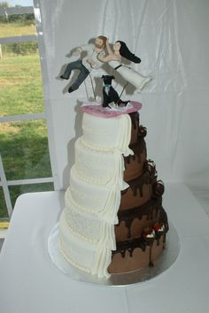Sarah & Garette's Wedding Cake - 5 tier wedding cake with 3 tiers of chocolate cake with strawberry cream filling, 2 tiers of strawberry cake with chocolate filling. All iced with butter cream then covered with chocolate marshmallow fondant then half covered with white marshmallow fondant. Piping details with butter cream icing, chocolate ganache for drips on chocolate side. Strawberries dipped in white and milk chocolate and detailed with milk chocolate.