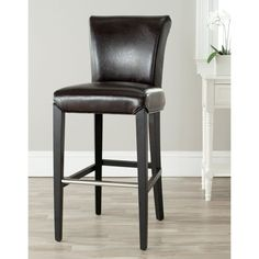 Classic and elegant, this bar stool features a brown bi-cast leather seat and a stylish curved back. This bar stool is finished with black wood legs.