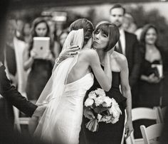 The bride and her mother at the wedding ceremony. Photo by Joy Marie Studios.