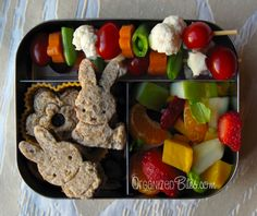 Adorable #bento school lunch with vegetable skewers, fruit salad, and mini sandwiches