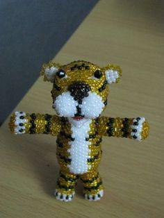 Another beaded tiger - I think I'd keep all his legs the same proportion, though.