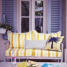 Zesty lemon garden area wtih striped yellow chair | Sunshine yellow colour schemes - 10 of the best | yellow | colour | housetohome.co.uk
