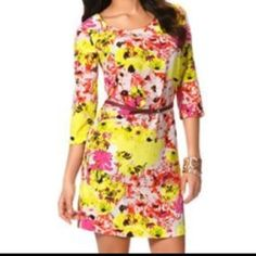 Neon Yellow & pink floral dress with belt Gorgeous floral dress in shades of yellow and pinks. Light weight fabric that feels silly and rich. Very high quality dress. Comes with a matching belt. Zip back. 3/4 sleeves. Worn once! Size small but can definitely fit a medium. It's a bit of a larger fit since the belt cinches the waist. Daisy Fuentes Dresses