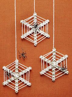 Oh, what a web we weave when making these for Halloween! Paint three craft sticks silver and let them dry. Glue them together at the center, forming an asterisk shape. Tie one end of a length of yarn (we used about 2 yards for one web) to the center of the sticks. Wrap it around the other spokes, then move outward, wrapping the sticks as shown. Tie off the yarn and add a plastic spider.�