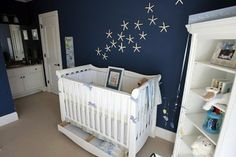 nautical nursery - love the white stars against the navy wall