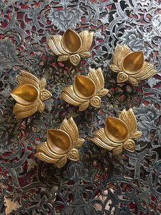 Beautiful diyas made of brass and shaped like a lotus is part of Ethnic home decor -