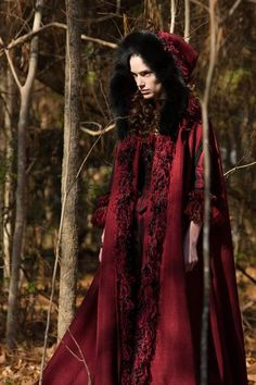 Deep red wool cape trimmed in a multi textured chenille and black fox. Season 1.