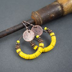 tribal hoop earrings • yellow vinyl discs • Vulcanite • African earrings • hand hammered copper discs • copper rings • circle earrings by entre2et7 on Etsy