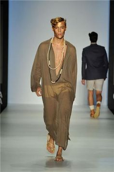 Toga Inspired clothing, but actually constructed. Even the hair pays tribute to Caesars gold leaf crown and elegance.