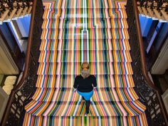 Wednesday: A member of the Royal Academy staff walks on British artist Jim Lambie's installation, titled Zobop, during the press preview of the Royal Academy Summer Exhibition. The annual event featuring over 1,100 art works runs from June 8 to Aug. 16. (Leon Neal/AFP/Getty Images)